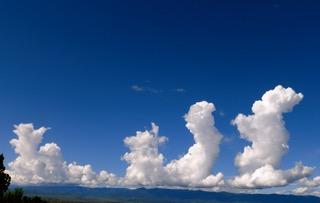 Three clouds in blue sky.